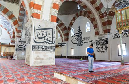 edirne: EDIRNE - TURKEY, JULY 12: Undefined muslims prayer in Edirne Old Mosque on july 12, 2016. The Old Mosque is an early 15th century Ottoman mosque in Edirne, Turkey