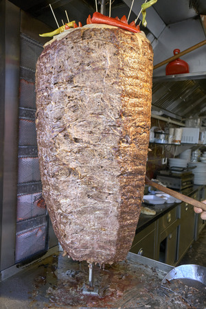 donner: Turkish dish made of meat cooked on a vertical spit and sliced off to order. Alternative names include kebap, donair, doner or donner.