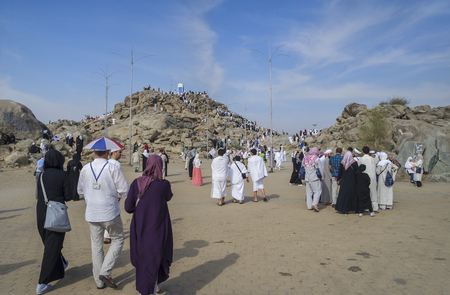 overthrown: MECCA, SAUDI ARABIA - FEB 3: Muslims at Mount Arafat (or Jabal Rahmah) February 3, 2015 in Arafat, Saudi Arabia. This is the place where Adam and Eve met after being overthrown from heaven.