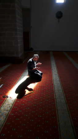 plea: After prayers, Muslims praying in a mystical environment Stock Photo