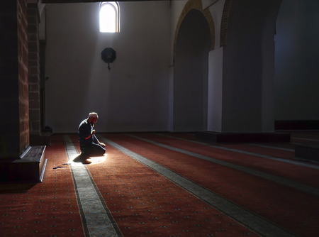 After prayers, Muslims praying in a mystical environment Stock Photo