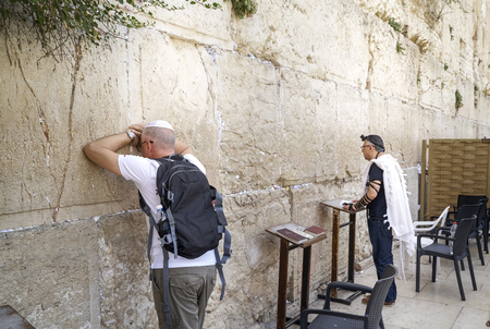 israelite: JERUSALEM, ISRAEL - JUNE 3: Jewish worshipers pray at the Wailing Wall. The most holy site for Jews. June 3, 2016 in Jerusalem, Israel.