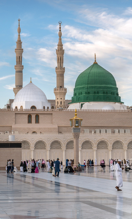 civilizing: MEDINA, KINGDOM OF SAUDI ARABIA (KSA) - FEB 1: Muslims marching in front of the mosque of the Prophet Muhammad on February 1, 2017 in Medina, KSA. Prophets tomb is under the green dome. Editorial