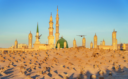 View of Baqee' Muslim cemetary at Masjid (mosque) Nabawi in Al Madinah, Kingdom of Saudi Arabia. Stock Photo - 75387856