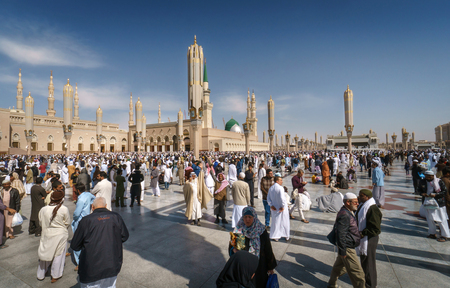 worshiped: MEDINA KINGDOM OF SAUDI ARABIA (KSA) - FEB 03: After Friday prayers Muslims gathered in front of the mosque of the prophet on February 03 2017 in Medina KSA. Prophets tomb is under the green dome.MEDINA, KINGDOM OF SAUDI ARABIA (KSA) - FEB 1: Muslims mar