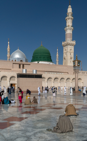 worshiped: MEDINA, KINGDOM OF SAUDI ARABIA (KSA) - FEB 2: Muslims marching in front of the mosque of the Prophet Muhammad on February 2, 2017 in Medina, KSA. Prophets tomb is under the green dome.