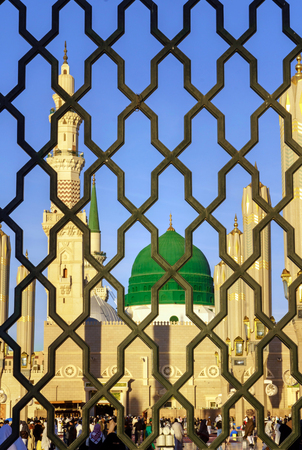 civilizing: MEDINA, KINGDOM OF SAUDI ARABIA (KSA) - FEB 03: Iron railings behind the mosque of the Prophet Muhammad on February 03, 2017 in Medina, KSA. Prophets tomb is under the green dome.