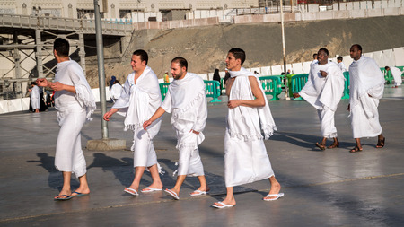 worshiped: MECCA, SAUDI ARABIA - JAN 30: Muslim wearing ihram clothes and ready for Hajj on January 30, 2017 in Mecca, Saudi Arabia. Muslims all around the world face the Kaaba during prayer time. Editorial