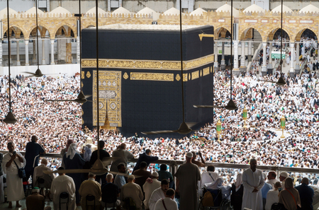 erecting: MECCA SAUDI ARABIA  JANUARY 28: Muslim pilgrims from all around the World revolving around the Kaaba on January 28 2017 in Mecca Saudi Arabia. Muslim people praying together at holy place.