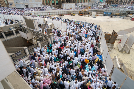 holiest: MECCA, SAUDI ARABIA - JANUARY 27, 2017: A thousand of Muslim walks on road between from Masjidil Haram during hajj in January 27, 2017 in Mecca, Saudi Arabia. It is possible to see the same human population after every prayer. Editorial