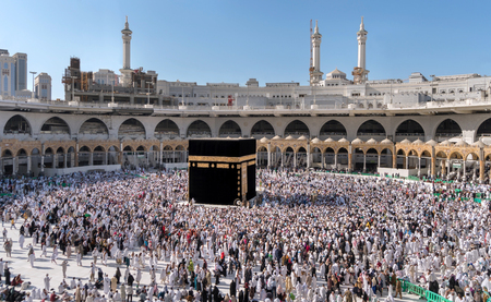 erecting: MECCA, SAUDI ARABIA - JANUARY 29: Muslim pilgrims from all around the World revolving around the Kaaba on January 29, 2017 in Mecca Saudi Arabia. Muslim people praying together at holy place.