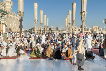 MEDINA, SAUDI ARABIA (KSA) - FEBRUARY 02: Muslims get ready to pray around Nabawi Mosque February 02, 2017 in Medina, KSA. Muslims from all over the world visit this place would do. Editorial