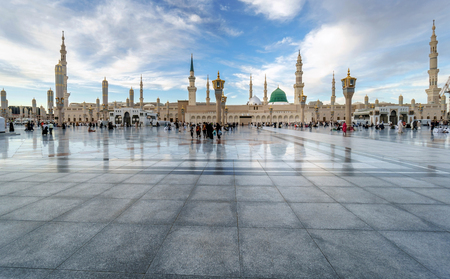 MEDINA, KINGDOM OF SAUDI ARABIA (KSA) - FEB 1: Muslims marching in front of the mosque of the Prophet Muhammad on February 1, 2017 in Medina, KSA. Prophets tomb is under the green dome. Editorial