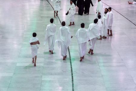 MECCA, SAUDI ARABIA - JAN 28: Muslim pilgrims reach Safa mount from Marwah mount on January 28, 2017 in Mecca. Muslim pilgrims perform 7 rounds of brisk walking from Safa mount to Marwah mount. Editorial