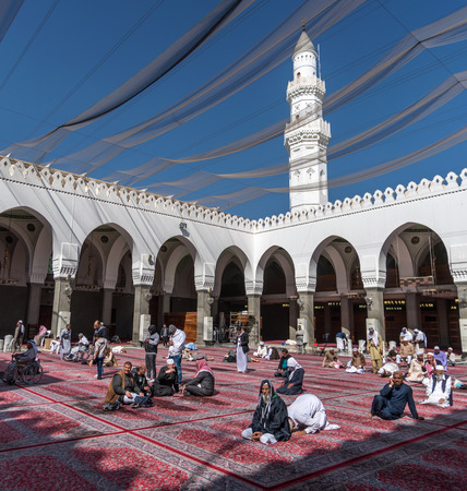 MEDINA, SAUDI ARABIA - FEBRUARY 02: Muslims pray inside Masjid Quba February 02, 2017 in Medina, Saudi Arabia. This is the first mosque built by Prophet Muhammad (pbuh) in Islam Editorial