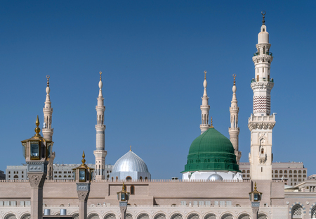 Exterior view of minarets and green dome of a mosque taken off the compound. Stock Photo
