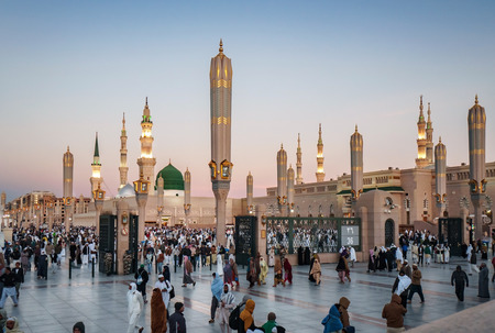 MEDINA, KINGDOM OF SAUDI ARABIA (KSA) - FEB 3: Muslims marching in front of the mosque of the Prophet Muhammad on February 3, 2017 in Medina, KSA. Prophets tomb is under the green dome. Editorial