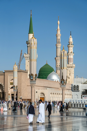 MEDINA, KINGDOM OF SAUDI ARABIA (KSA) - FEB 2: Muslims marching in front of the mosque of the Prophet Muhammad on February 2, 2017 in Medina, KSA. Prophets tomb is under the green dome.