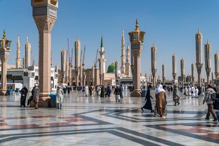 civilizing: MEDINA, KINGDOM OF SAUDI ARABIA (KSA) - FEB 2: Muslims marching in front of the mosque of the Prophet Muhammad on February 2, 2017 in Medina, KSA. Prophets tomb is under the green dome.