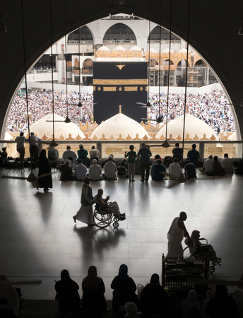 MECCA, SAUDI ARABIA - JANUARY 28: Muslim pilgrims from all around the World revolving around the Kaaba on January 28, 2017 in Mecca Saudi Arabia. Muslim people praying together at holy place. Editorial
