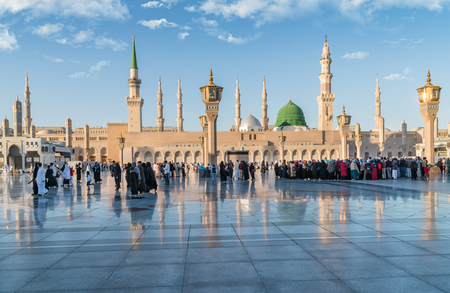 MEDINA, SAUDI ARABIA (KSA) - FEB 2: Muslims marching in front of the mosque of the Prophet Muhammad on February 2, 2017 in Medina, KSA. Prophets tomb is under the green dome.