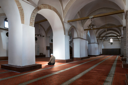 Muslims praying in a mystical environment inside mosque.