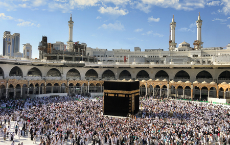 MECCA SAUDI ARABIA  JANUARY 29: Muslim pilgrims from all around the World revolving around the Kaaba on January 29, 2017 in Mecca Saudi Arabia. Muslim people praying together at holy place. Editorial