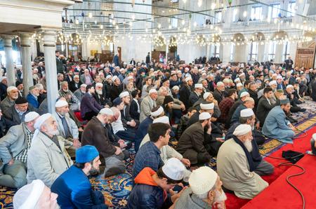 ISTANBUL, TURKEY - DEC 3, 2017: Friday pray in congregation male Muslims Fatih Mosque on December 3, 2017 in Istanbul, Turkey.