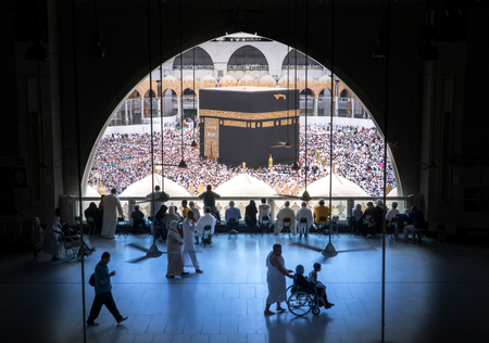 MECCA SAUDI ARABIA  JANUARY 28: Muslim pilgrims from all around the World revolving around the Kaaba on January 28 2017 in Mecca Saudi Arabia. Muslim people praying together at holy place.