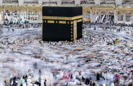 MECCA, SAUDI ARABIA - JANUARY 29: Muslim pilgrims from all around the World revolving around the Kaaba on January 29, 2015 in Mecca Saudi Arabia. Muslim people praying together at holy place.