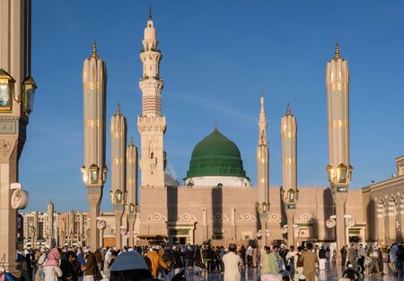 MEDINA, KINGDOM OF SAUDI ARABIA (KSA) - FEB 3: Muslims marching in front of the mosque of the Prophet Muhammad on February 3, 2017 in Medina, KSA. Prophet's tomb is under the green dome.