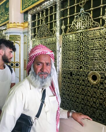 MEDINA, SAUDI ARABIA - JUNE 24, 2019: Unidentified Muslims in front of the tomb of the Prophet of Islam Muhammad on June 24, 2019 in Madinah, Saudi Arabia. His grave was designed in oriental style.
