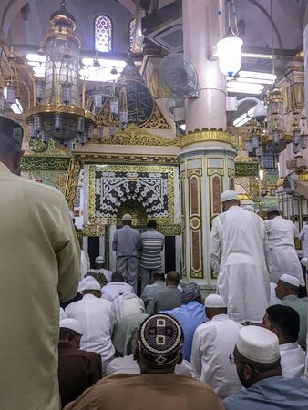 MEDINA, SAUDI ARABIA - JUNE 25: A crowd of Muslim men searching for an empty spot to pray in the Ravza-i Mutahhara on June 25, 2019 in Madinah, Saudi Arabia. Ravza-i Mutahhara in Masjid Al Nabawi is so special it is called as garden from the Heaven on Ear Editöryel