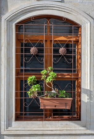 Vintage window with flowers and decorative iron railings in Istanbul, Turkey. Stockfoto