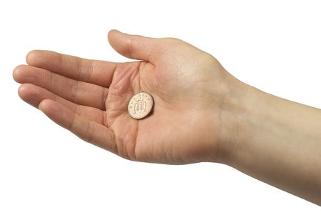 penny: Hand holding one pence piece