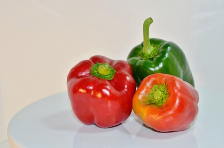 homegrown: Fresh Organic homegrown red, orange and green bell peppers Stock Photo