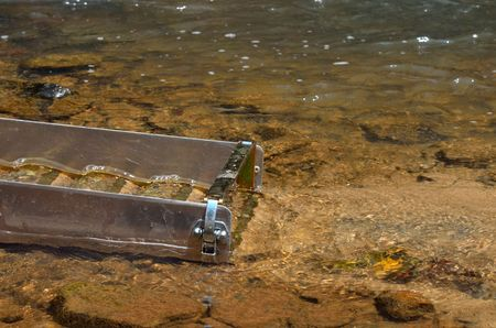panning: Gold panning with a sluice box