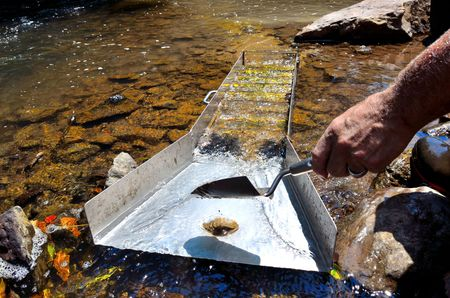 Gold panning with a sluice box