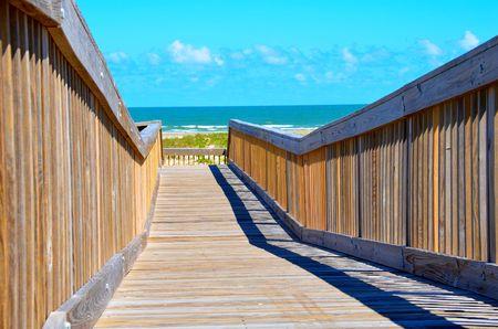 Wood bridge walkway to the sand and sea of Galveston, Texas, USA