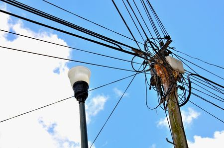 conductor electricity: Electricity wires on city street