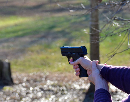 target shooting: Target shooting with a fire arm - pistol Stock Photo