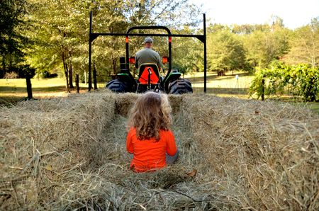 Young girl on hay ride