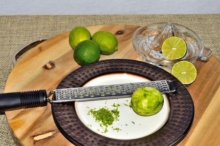 Glass juicer and zester with fresh limes