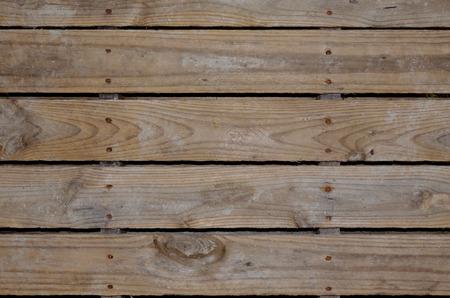 Envejecidos tablas de palets de madera para el fondo o telón de fondo