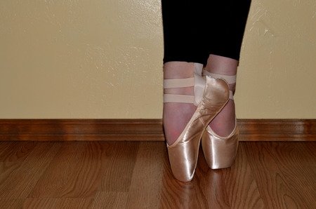 tiptoes: Ballet point slippers, dancer standing on tiptoes