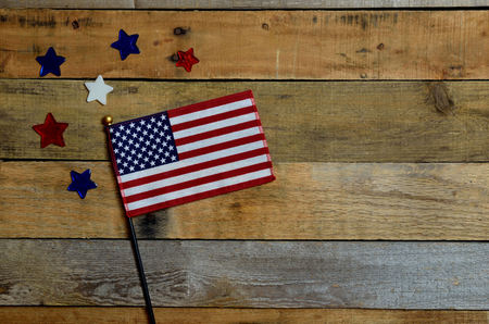 presidents' day: American flag with red, white and blue star, set on pallet wood