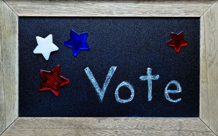Vote notice, surrounded by red, white and blue stars and a wooden frame.