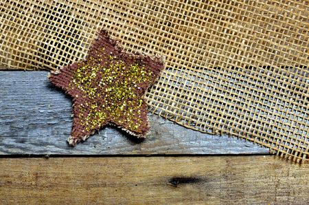 twinkle: Twinkle on star set on mesh and pallet wood background Stock Photo