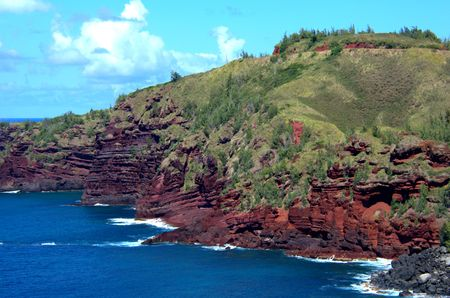 ridge of wave: Tropical ocean shoreline, red rock and sediment. Stock Photo
