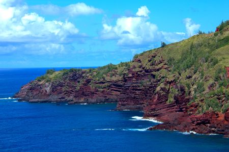 sediment: Tropical Hawaii red rock and sediment shoreline Stock Photo